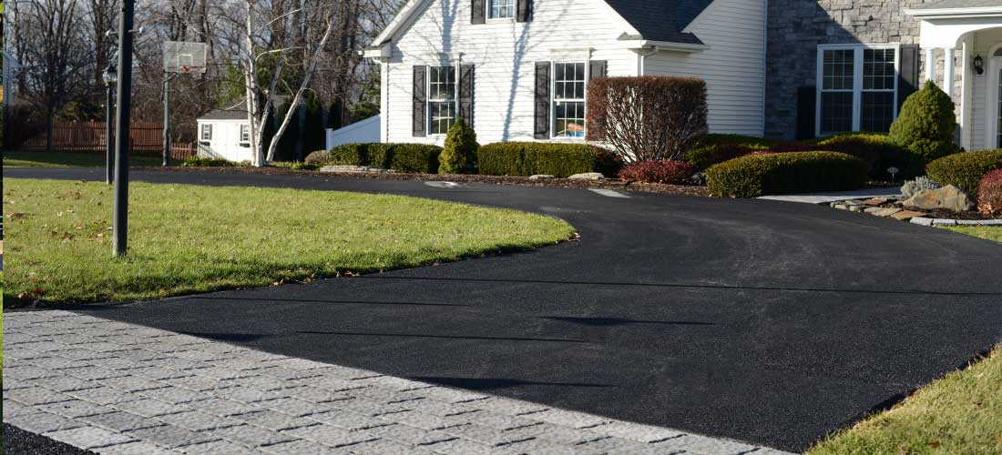 new residential driveway paving with inlaid paver blocks